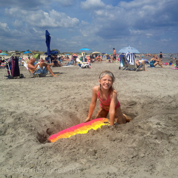 playing in the sand in Avalon, NJ