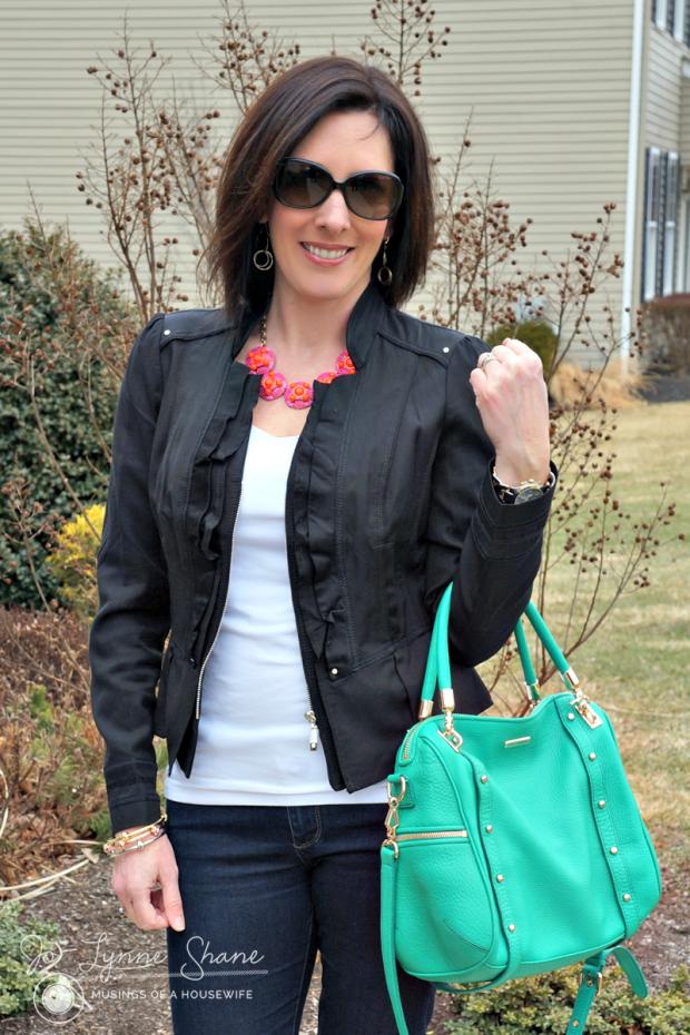 black jacket green bag