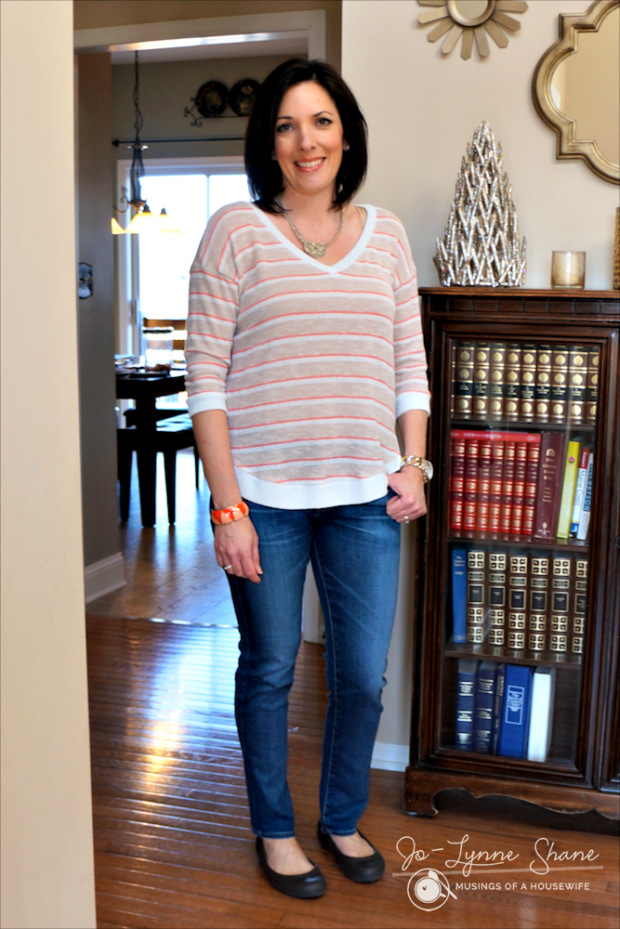 medium wash jeans with coral striped sweater
