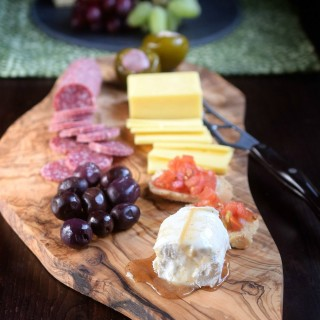 Cheese & Fruit on a Cutting Board makes a rustic and beautiful presentation for casual entertaining!