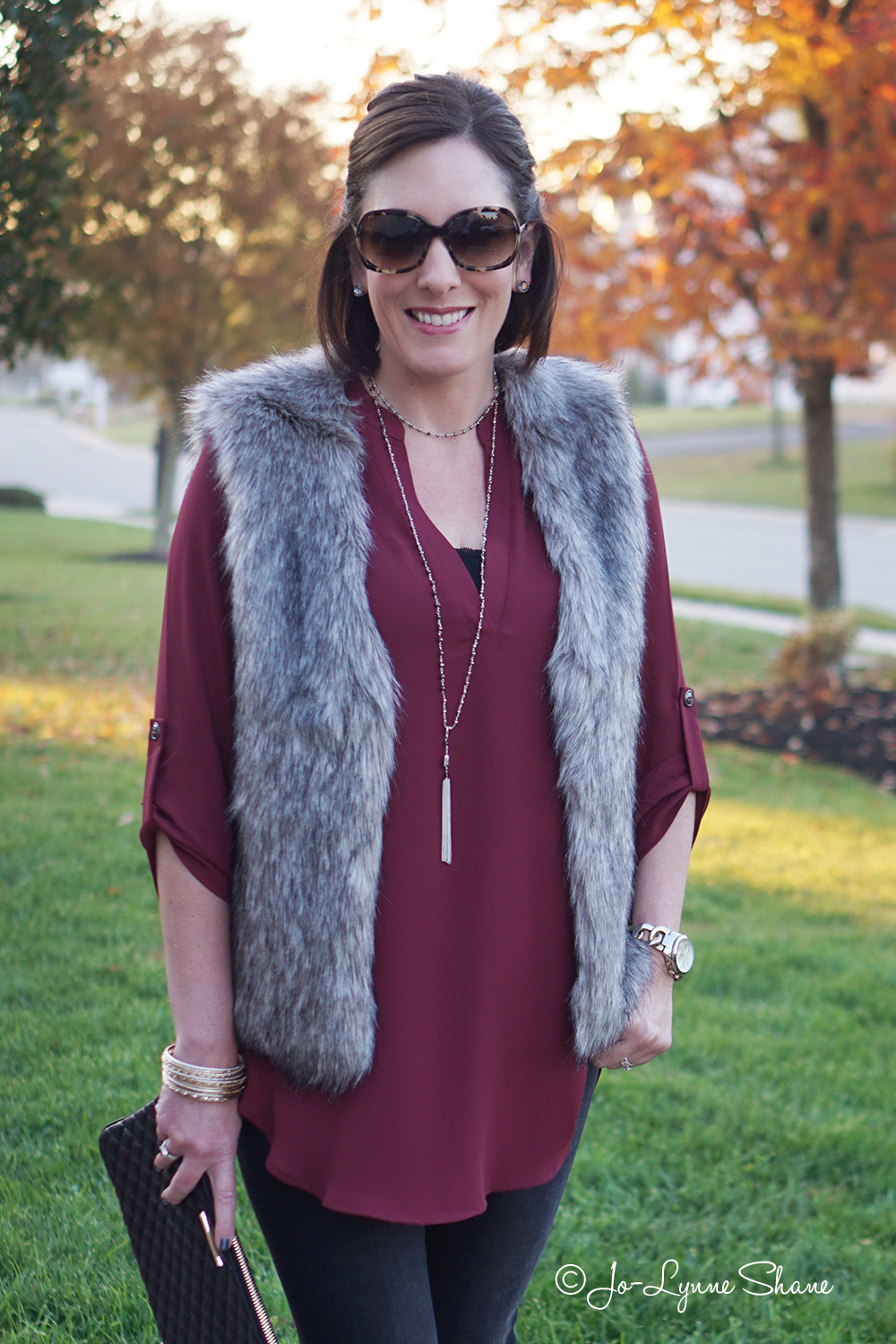 How to wear a faux fur vest with jeans