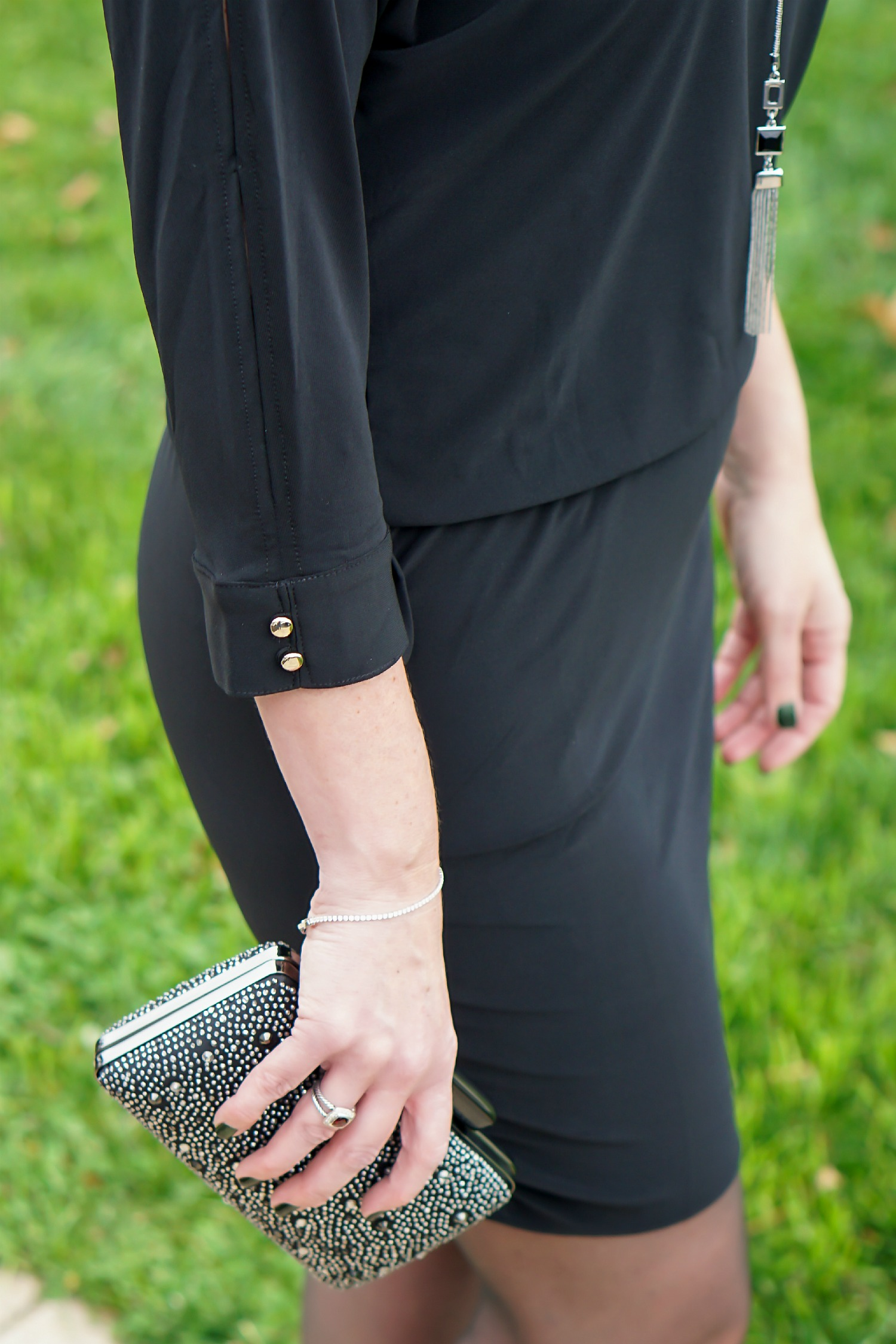 What to Wear to an Office Christmas Party: LBD with fun accessories, sheer black hose, and black suede pumps