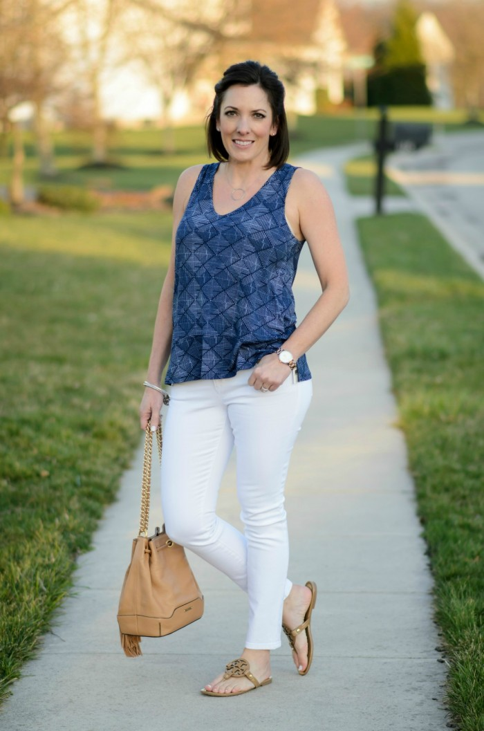 Spring fashion with this relaxed split hem printed top from Old Navy, white jeans, and nude sandals!