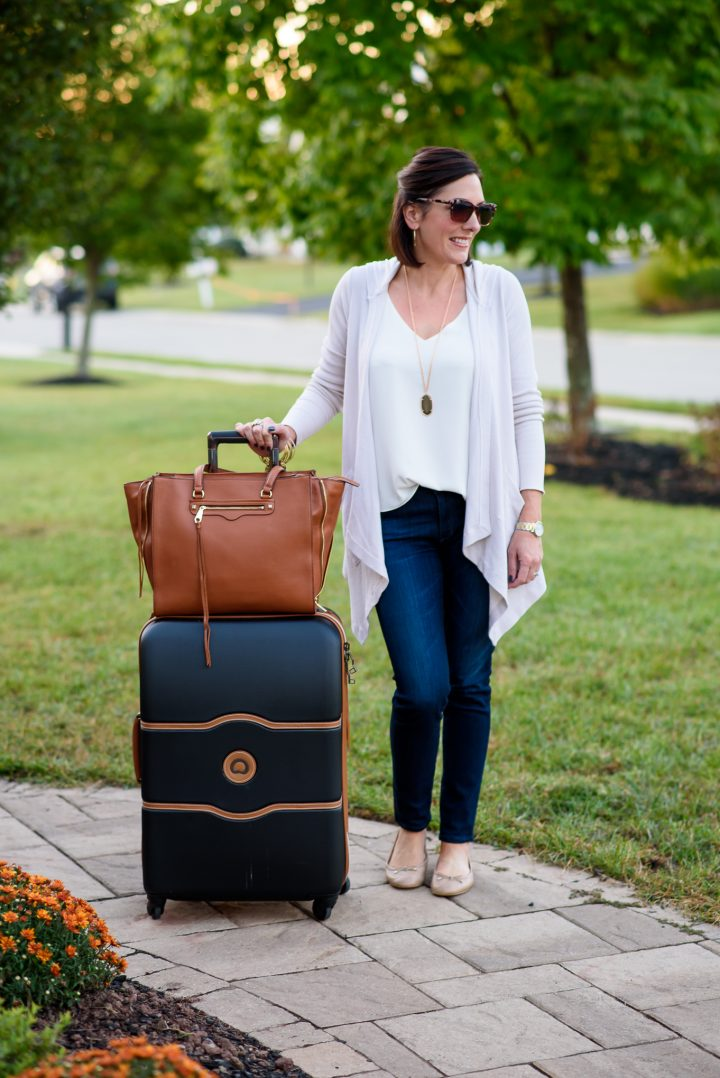 This casual fall travel outfit combines several neutrals that are all pieces I can mix and match with other items in my suitcase while I'm away.