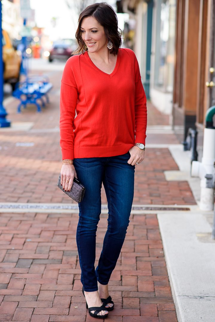 I've teamed up with @RidersbyLee to style a budget-friendly holiday date night outfit featuring their Bounce Back Skinny Jeans with a red sweater and black sparkly dress sandals from Payless.
