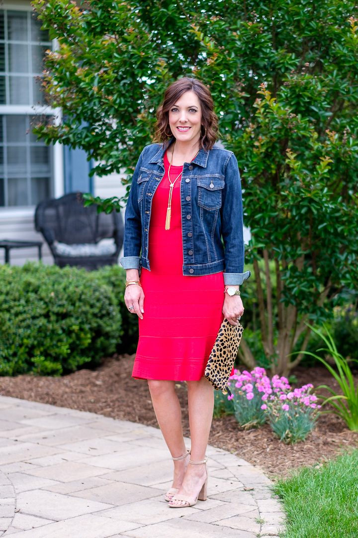 Today I'm teaming up with Nordstrom to style a fun and flirty look featuring a red sleeveless summer sweater dress with a denim jacket, neutral block heel sandals, and leopard clutch.