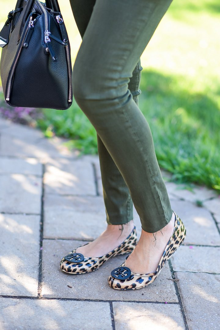 How to Wear Spruce Green Jeans: I topped my spruce green skinnies with a white cami and cognac moto jacket and finished the look with leopard flats and a black satchel.