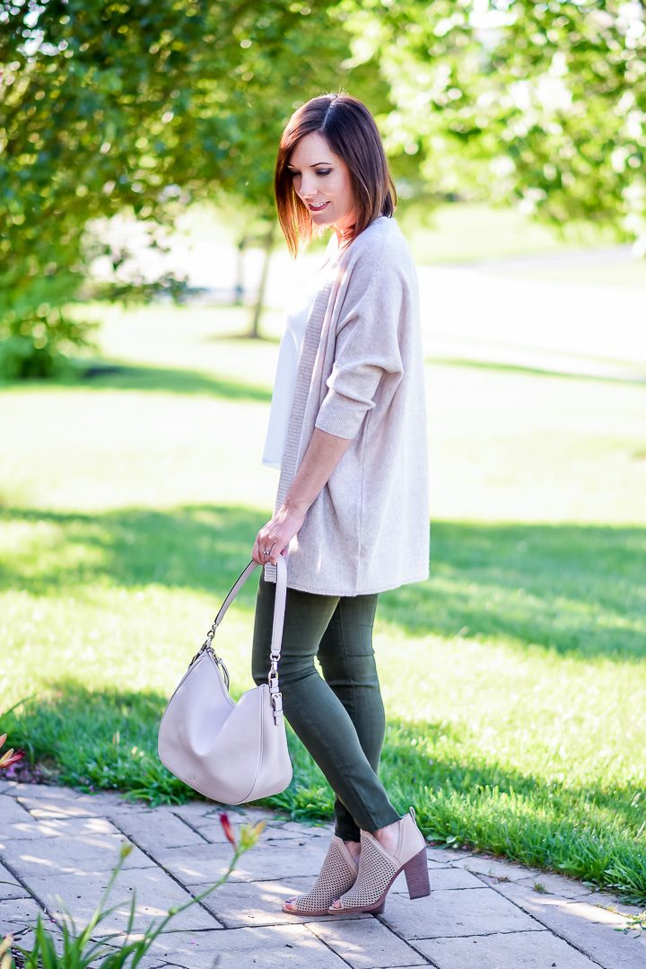 How to Wear Spruce Green Jeans: I topped my spruce green skinny jeans with a white cami and blush cardigan, and I added a pair of perforated peep toe booties in a coordinating shade of blush. Blush and spruce are a great combination, and I like how this combination lightens up the dark green jeans.